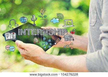 Internship Concept With Young Man Holding His Tablet Computer