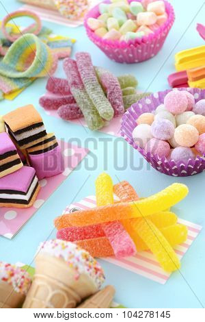 Bright Colorful Candy On Pale Bluw Wood Table.
