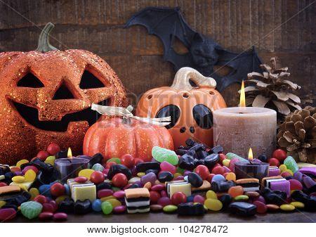 Halloween Candy With Pumpkins On Dark Wood Background.