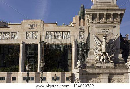 Eden Teatro And Column Monument In Lisbon