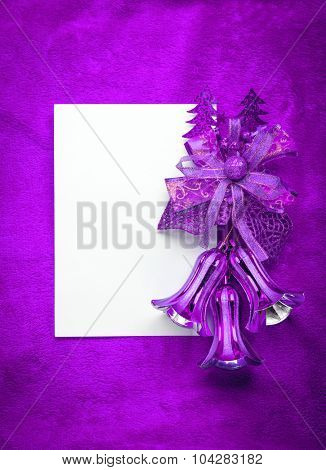Christmas card blank white paper on purple.