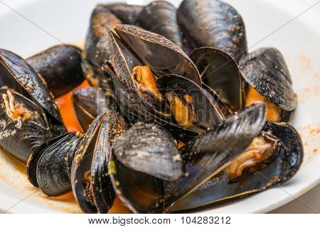A Dish Of  Mussels Pics With Tomato Sauce, Open.