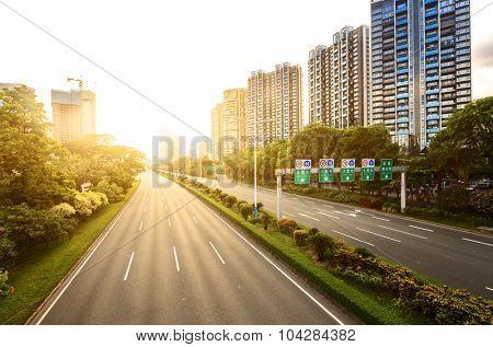 empty asphalt road in modern city under twilight