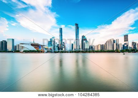 skyscrapers of a modern city along a river