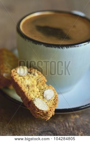 Cantuccini And Coffee In A Blue Cup.tinted Photo.