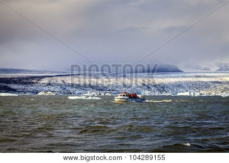 Jokulsarlon Lagoon, Iceland - September 13, 2013: Amphibious vehicle takes tourists on iceberg watching tour in Jokulsarlon glacier lagoon in Southern Iceland