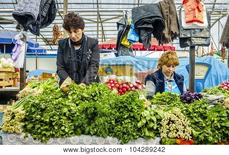 Pyatigorsk, Russia, April 3, 2015: Fresh produce vendors at farmers market in the southern Russian city of Pyatigorsk.