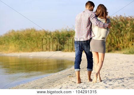 Young couple on the riverside
