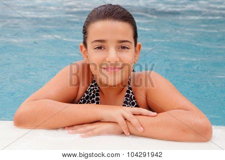 Pretty child girl swimming in the pool
