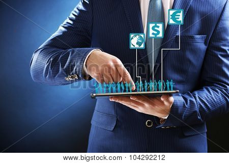 Businessman holding a tablet with a projected on-screen bar graph exchange rates. Business concept
