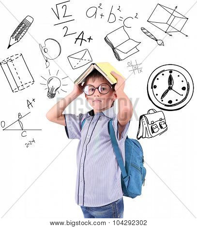 Little schoolboy  with school  icons, isolated on white