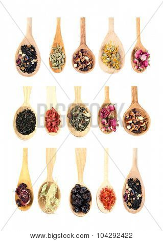 Collection of tea and natural additives in wooden spoons, isolated on white