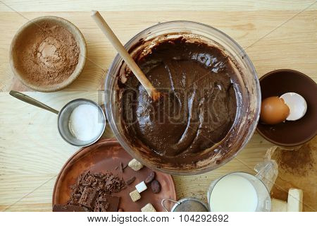 Preparing dough for chocolate pie on table close up
