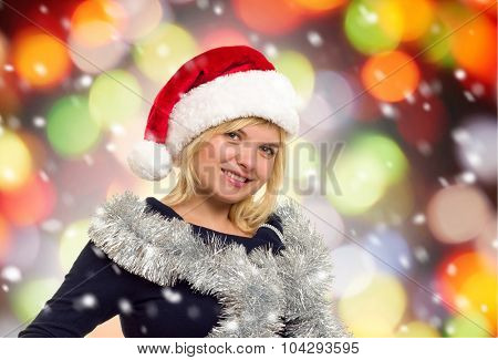 christmas holiday portrait woman in santa hat on colorful background with snow
