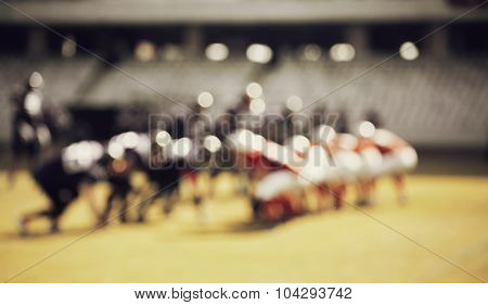 American football game - out of focus background of the field - retro styled photo