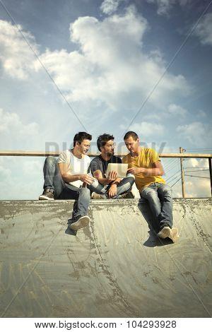 Three men sitting together