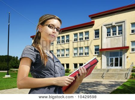 Student In Front Of School Entrance