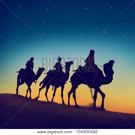 Three Wise Men Riding Camel Desert Dusk Concept