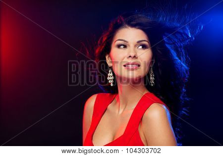people, holidays, disco, night lifestyle and leisure concept - beautiful sexy woman in red dress at nightclub