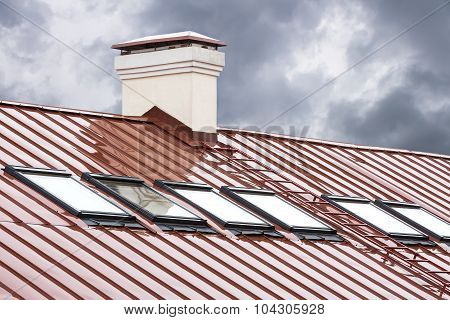 Red Metal Roof With Row Of Skylights
