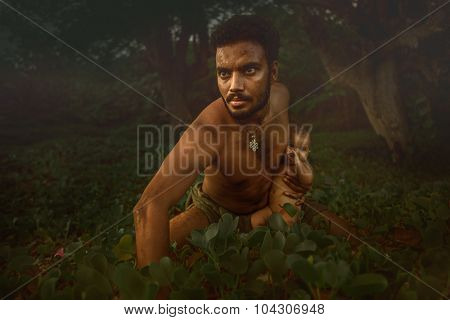 Close up muscular man posing with his baby