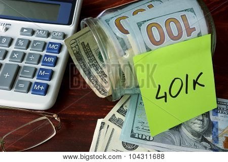 Jar with label 401k and money on the table.