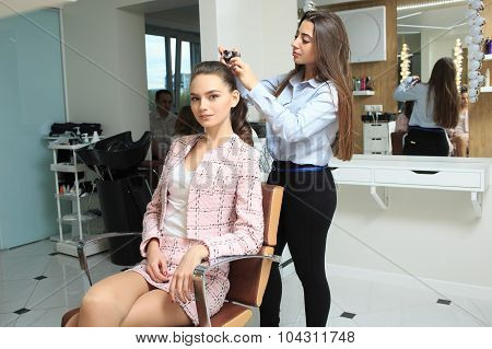 Young girl make hairstyle in a beauty salon