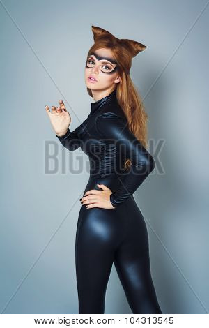 Young Woman In Latex Black Cat Costume