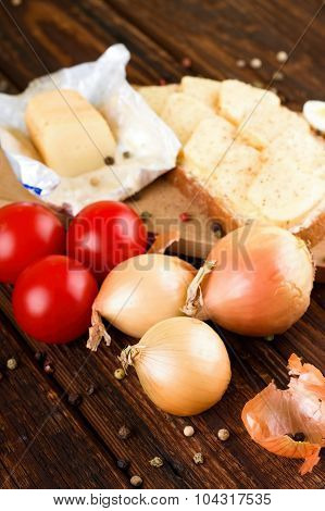 Onions And Vegetable With Aromatic Cheese On Bread