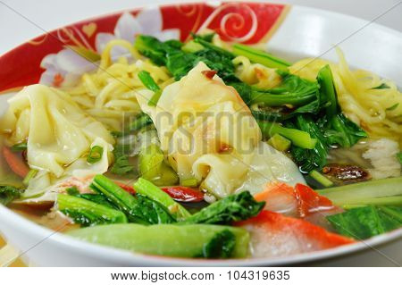 egg noodle with barbecue pork and wanton with soup on bowl