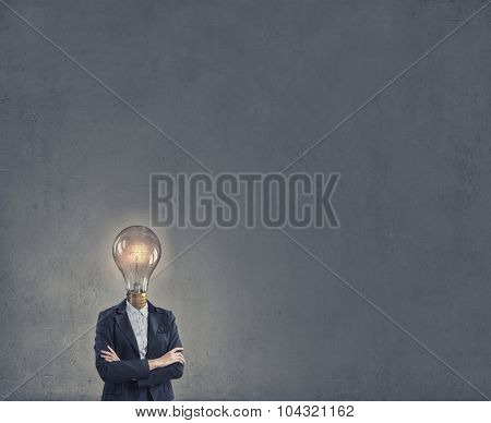 Businesswoman in suit with light bulb instead of head
