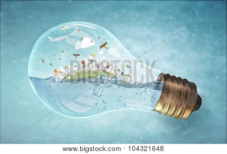 Glass light bulb with water and cityscape inside
