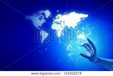Person hand taking world map on blue background