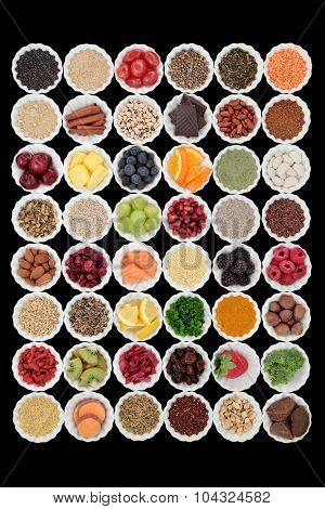 Large superfood selection in porcelain crinkle bowls over black background. High in vitamins and antioxidants.