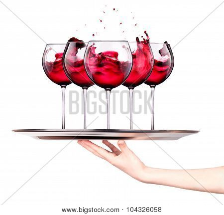 Waitress holding tray with wine glasses