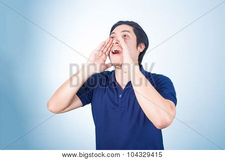 Portrait Of Asian Guy Yelling, Screaming, Shouting, Hand On His Mouth