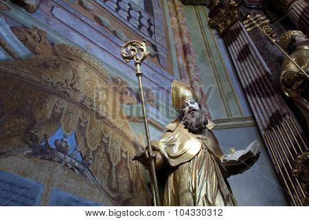 LEPOGLAVA, CROATIA - SEPTEMBER 21: Saint Ambrose on the main altar of Holy Cross, parish Church of the Immaculate Conception of the Virgin Mary in Lepoglava on September 21, 2014