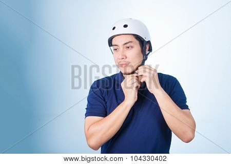Asian Guy With Bicycle Helmet And Gloves