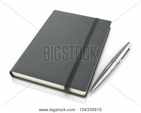 Black Leather Notebook And A Silver Pen On A White Background.