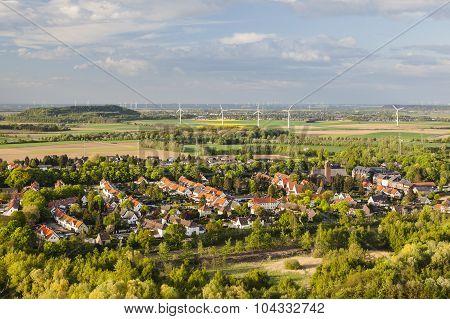 Village And Wind Turbines