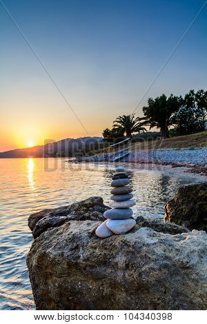 Turret Pebbles At Sunset With Ocean On Background. Relaxing Stones.