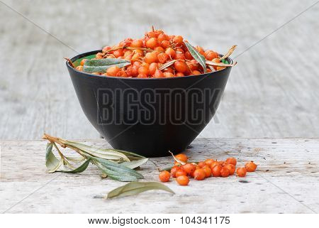 Sea Buckthorn In A Bowl On A Plank