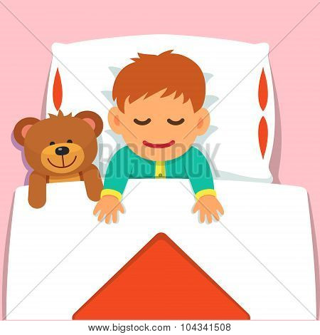Baby boy sleeping with his plush teddy bear toy