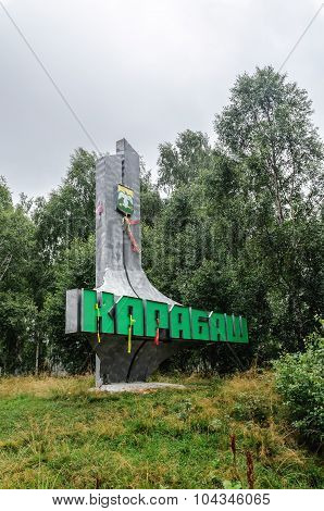 KARABASH RUSSIA - AUGUST 6 2009. Stele at the entrance to Karabash - small industrial town in Southern Urals