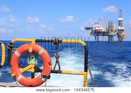 Life Ring On The Offshore Supply Boat With Jack Up Drilling Rig Background - Oil And Gas