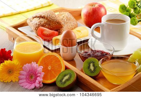 Breakfast On Tray Served With Coffee, Juice, Egg, And Rolls