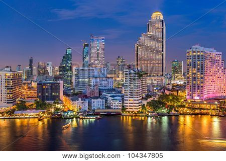 Bangkok, Thailand skyline on the Chao Phraya River.