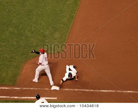 Giants Runner Slides  Back Into Base As Phillies Ryan Howard Catches Ball