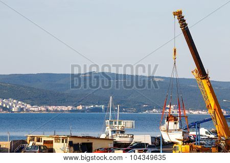 Moving Of Boat With Crane In A Port