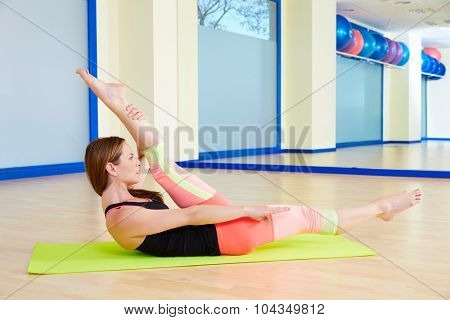 Pilates woman scissors exercise workout at gym indoor